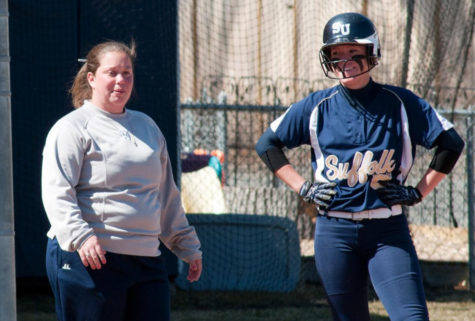 Softball swings into new season, catches warm weather