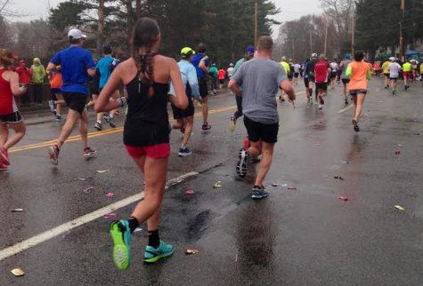 Students, staff race across Boston Marathon finish line