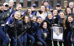 Davis makes softball history, again