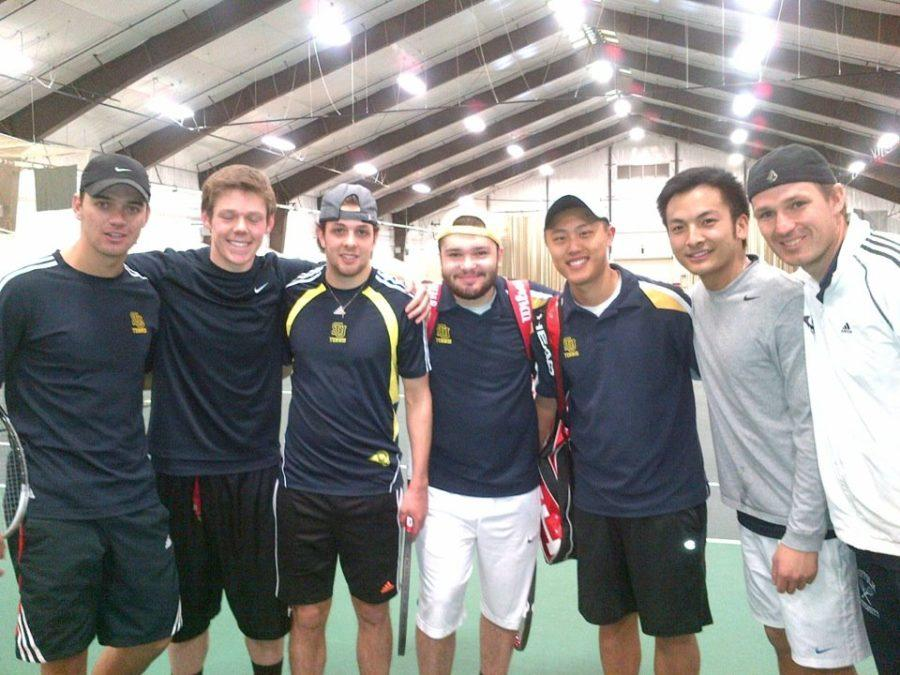 Members of the Suffolk University men's tennis team pose after their match against Norwich University in Vermont on Saturday.
