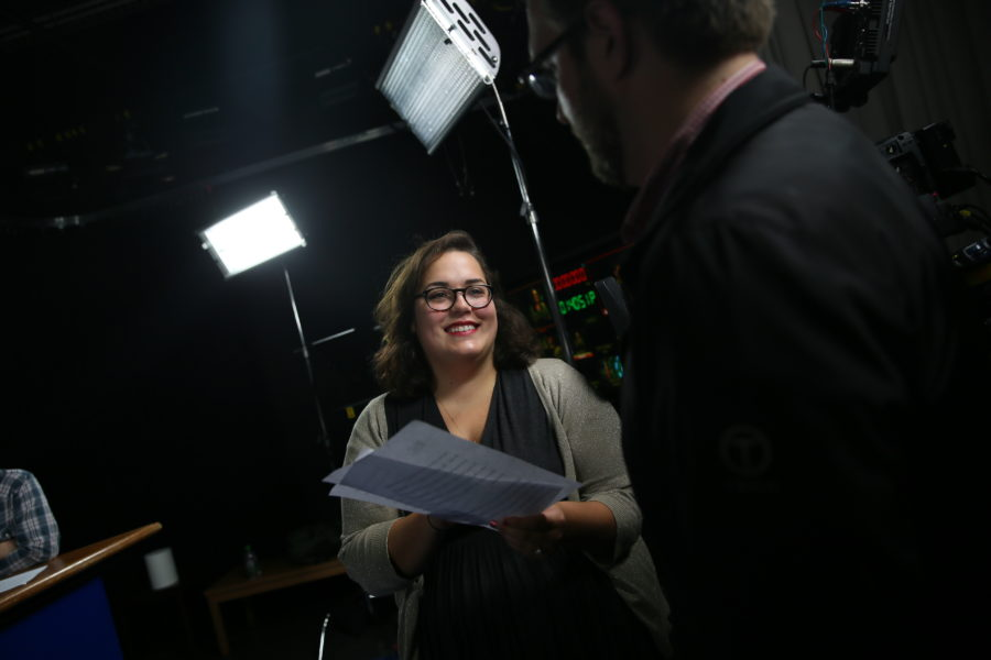 Rebecca Bishop smiling while working at Suffolk  (Photo courtesy of Suffolk's marketing and communications office)
