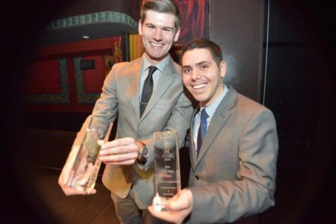Dan McCarthy and Dan Lampariello show off their winnings at the 2014 awards.