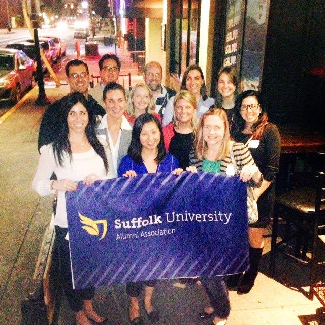 Suffolk alumni pose for a picture after a reception they held in San Diego.