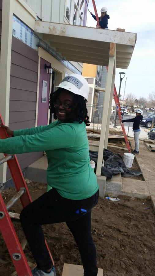 Gousby working on a Habitat for Humanity project in Denver during Alternative Spring Break  in March.
