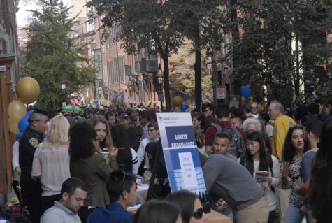 Suffolk University students packed Temple Street during the last involvement fair the school will host on it. Craig Martin/Journal Staff.