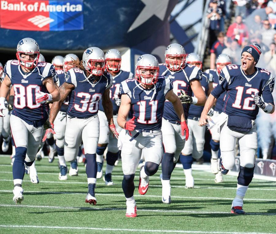 The Patriots run onto the home field at Gillette stadium. Courtesy of New England Patriots' Facebook.