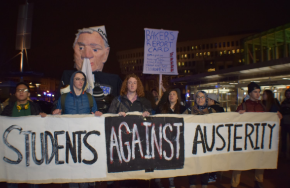 Some at the protest believe President Donald Trump and Massachusetts Governor Charlie baker have a tight agenda for the state of Massachusetts, and they want to reject that.   Morgan Hume/ Journal Staff