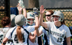 Softball swings into new season, catches warm weather