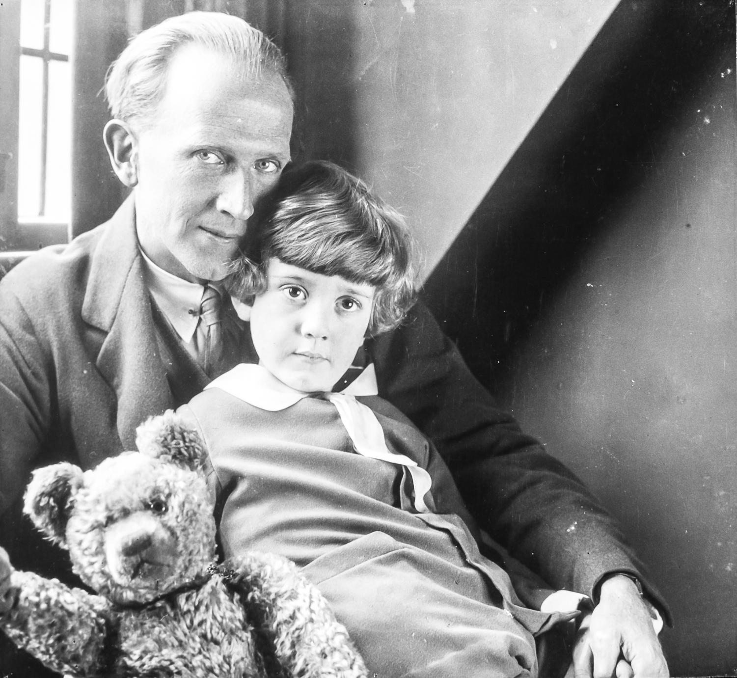 Author A.A. Milne posing with his son Christopher Robin Milne as Christopher holds his teddy bear in 1926.