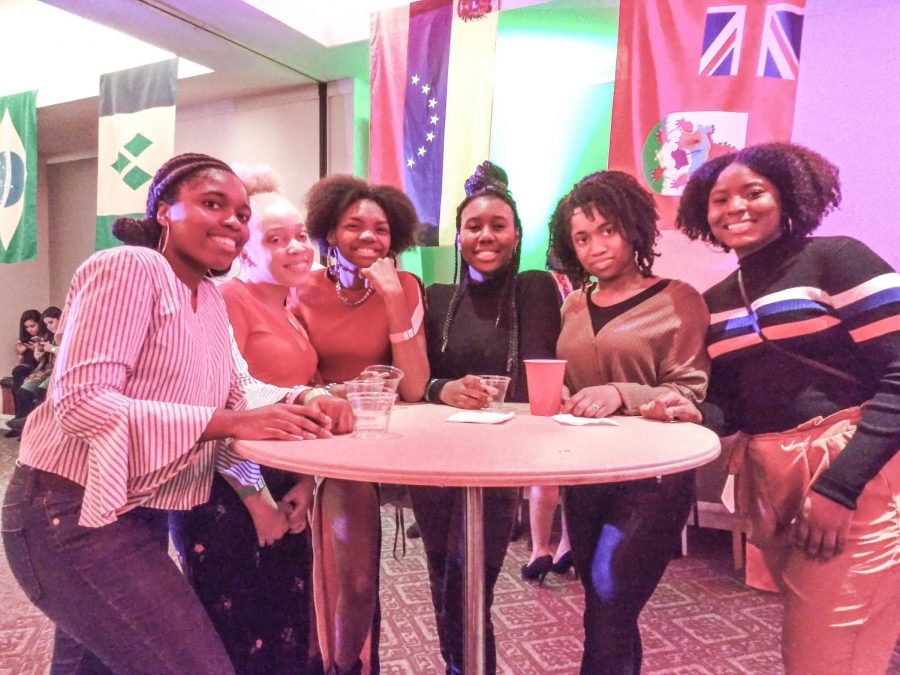 Members of the Caribbean Student Network celebrate caribbean culture and diversity in Sargent Hall's Function Room