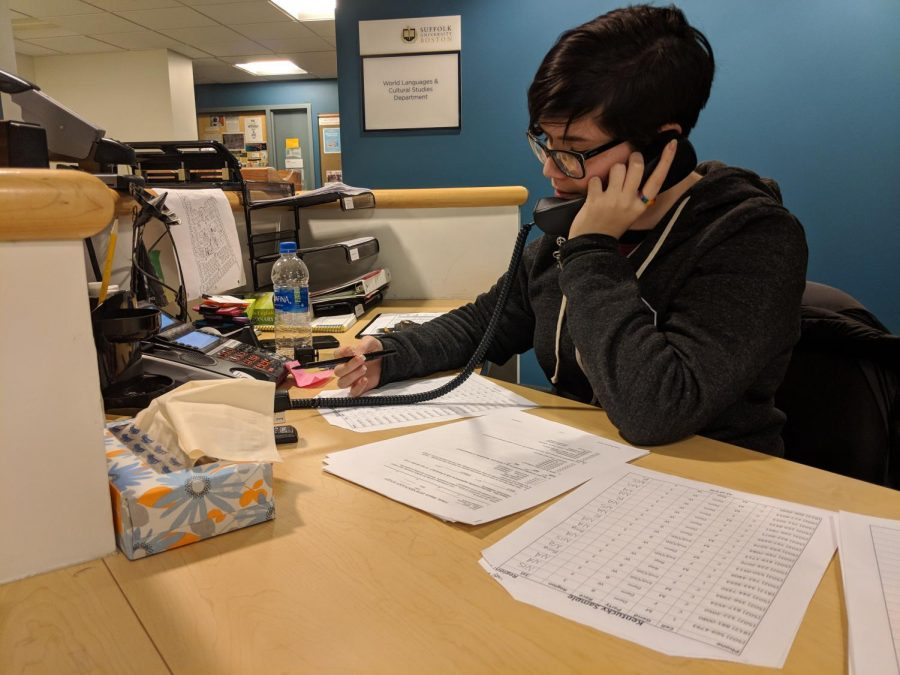 Suffolk+graduate+student+Marissa+Dakin+calls+one+of+hundreds+of+phone+numbers+to+complete+the+class+survey.+