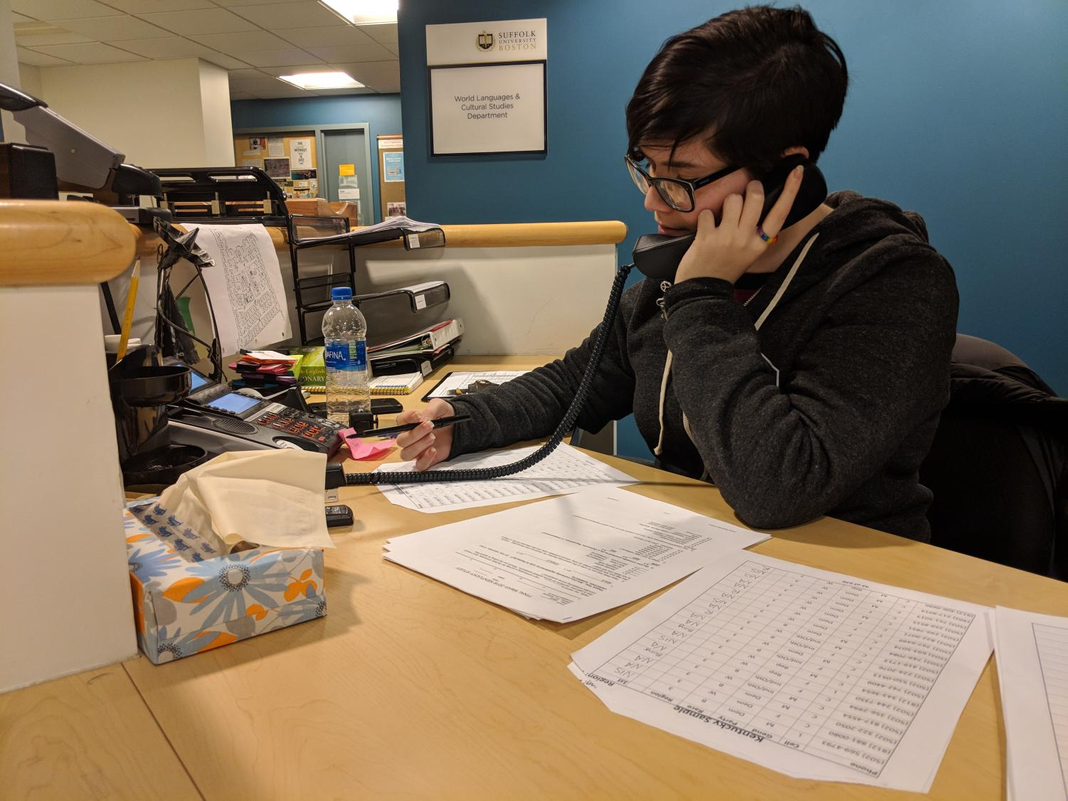 Suffolk graduate student Marissa Dakin calls one of hundreds of phone numbers to complete the class survey.