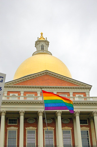A rainbow Pride flag flies in front of the Massachusetts State House in Boston