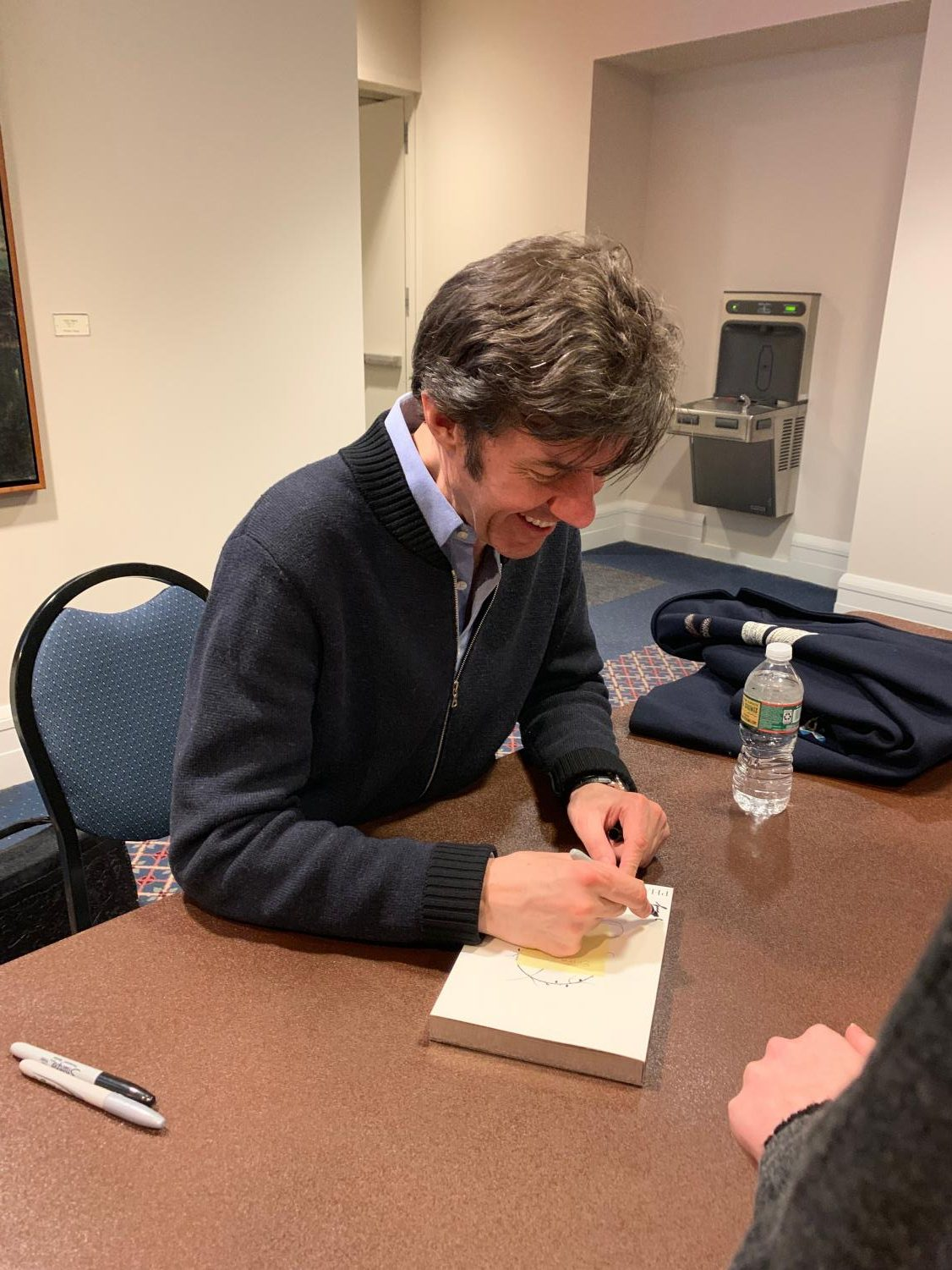 Stefan Sagmeister autographing books inside Sargent Hall