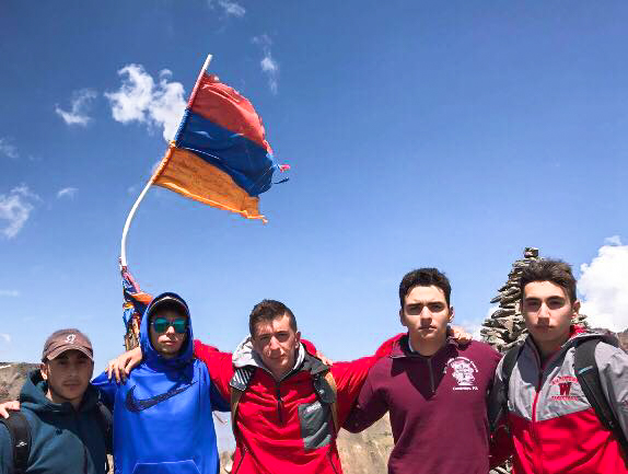 George Yeghyayan with friends on top of a mountain in Armenia