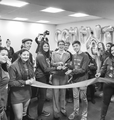 President and Vice President of Commuter Student Council Brian Hatch and Alexa Baugniet cut the ceremonial ribbon with Marisa Kelly, president of Suffolk University