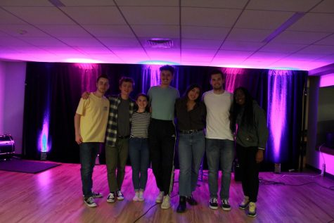 A group of musicians and music fans pose at the club's last open mic event of the semester on Friday