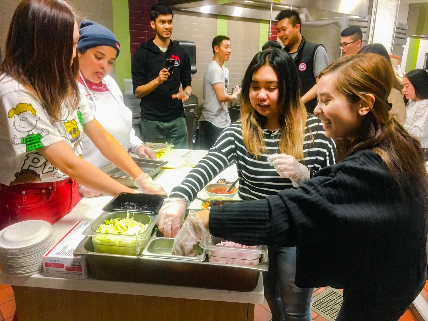 Asian American Association, Vietnamese Student Association and Off Campus Housing Office participate in Cooking 101: Roll into Spring