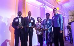 (From left) Suffolk University Dean of Students Shawn Newton, Suffolk Law School alumnus Damian Wilmot, Suffolk Law Dean of Students Office Coordinator Rosa Urena and Suffolk Alumnus Roxann Cooke – all honorees at Friday night's celebration– stand with Suffolk University President Marisa Kelly