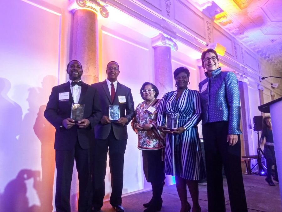 (From left) Suffolk University Dean of Students Shawn Newton, Suffolk Law School alumnus Damian Wilmot, Suffolk Law Dean of Students Office Coordinator Rosa Urena and Suffolk Alumnus Roxann Cooke – all honorees at Friday night