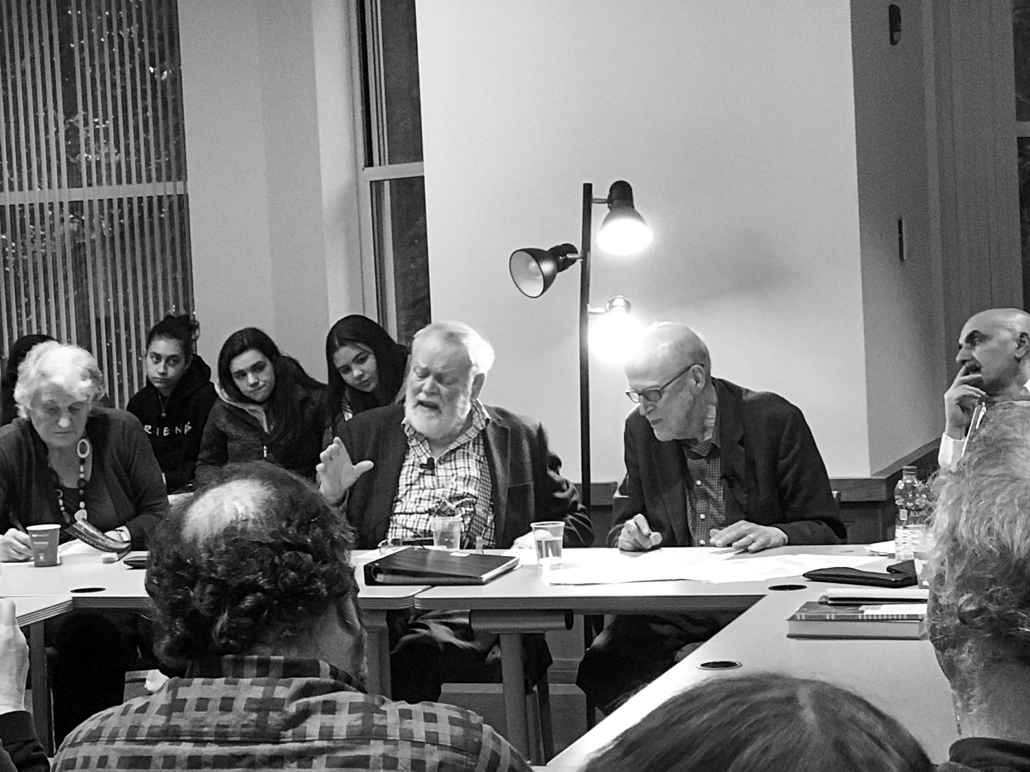 Poets Michael Longley and David Ferry inside the Poetry Center on Oct. 10 reading excerpts of famous literature to the audience