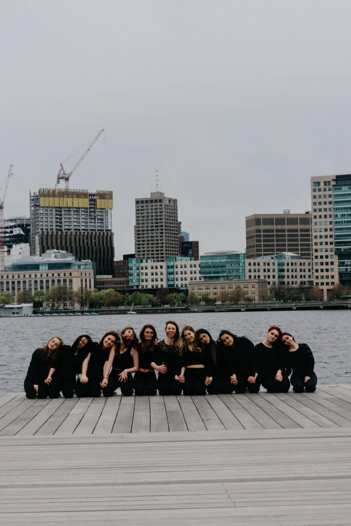 Members of the Suffolk University Dance Company (SUDC) strike a pose for a group snapshot along the Charles River Esplanade