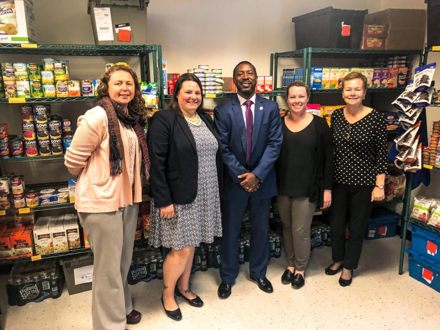 (From left to right) Assistant Dean of Students Danelle Berube, Director of Student Outreach and Support Amanda McGrath, Associate Dean of Students Shawn Newton, Director of Student Outreach and Support Janelle Grady and Dean of Students Ann Coyne stand in the Suffolk CARES Pantry