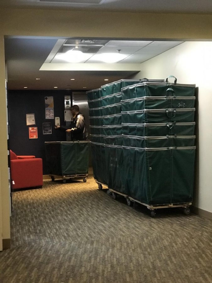 Carts were stacked in 10 West as students moved out of the building Sunday