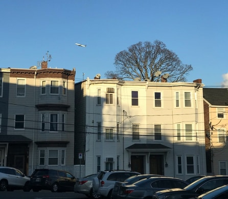 A row of apartments line an East Boston street