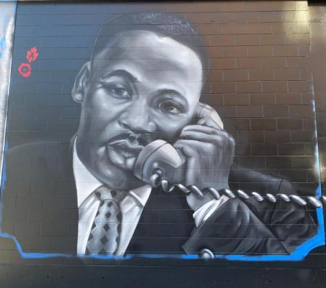 "Martin Luther King Jr. depicted in the ""Roxbury Love Story"" mural outside the Melnea Residence apartment complex. The mural was painted by local Boston artists Ekua Holmes and Rob Gibbs."