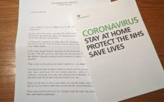 A pamphlet discusses the proper precautions needed for COVID-19.
