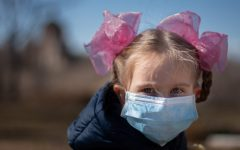 A young child wears a mask amidst coronavirus pandemic.