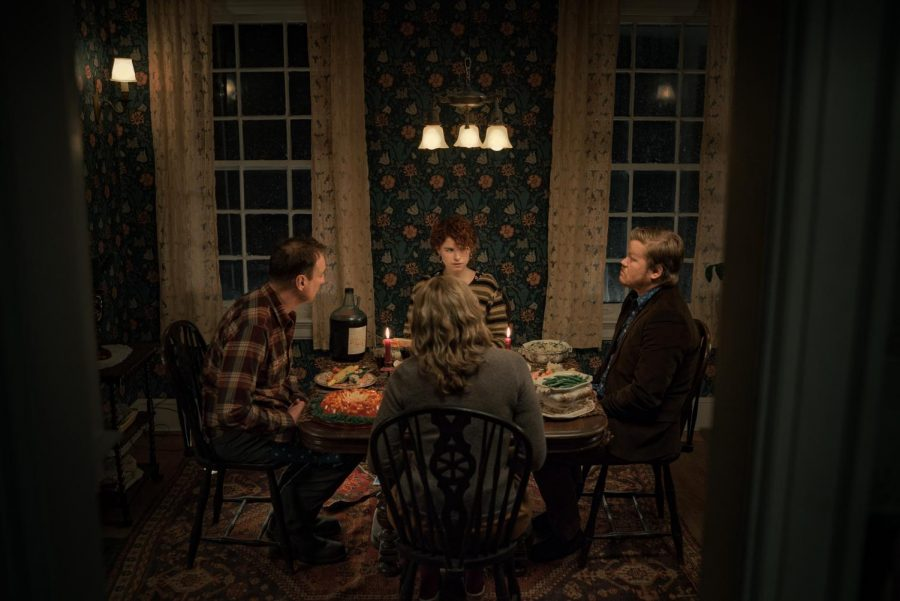David Thewlis as Father, Jessie Buckley as Young Woman, Toni Collette as Mother, and Jesse Plemons as Jake in an unsettling dinner scene in Charlie Kaufman's