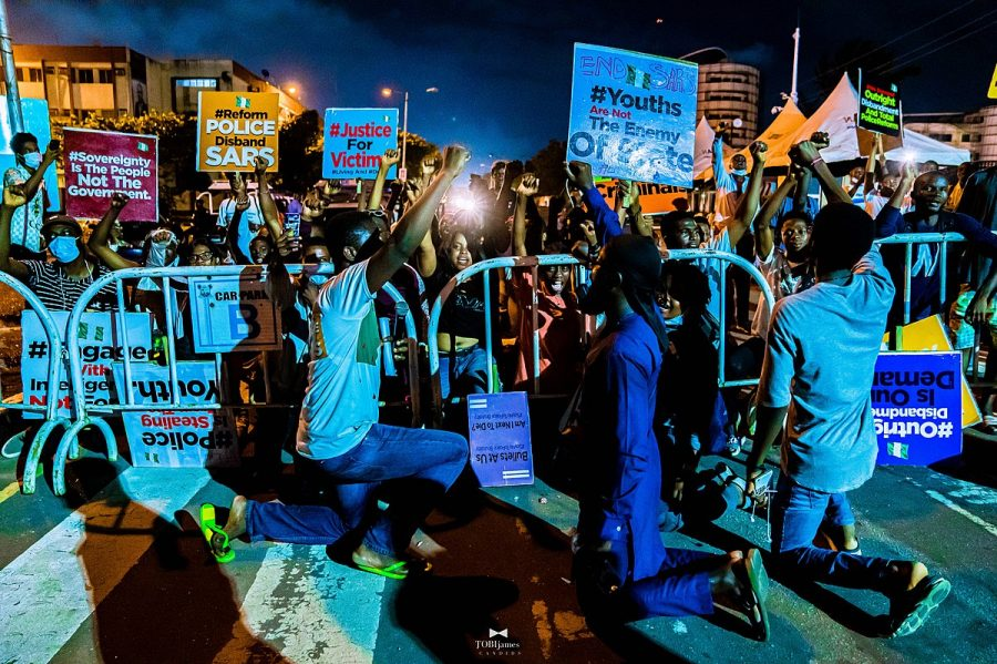 All+protesters+take+a+knee+as+the+Nigerian+National+Anthem+was+being+played+at+an+Oct.+8+protest+in+Nigeria.+