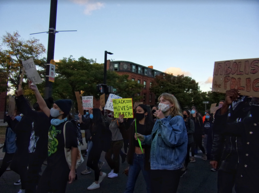 Protesters march through the streets of Boston.