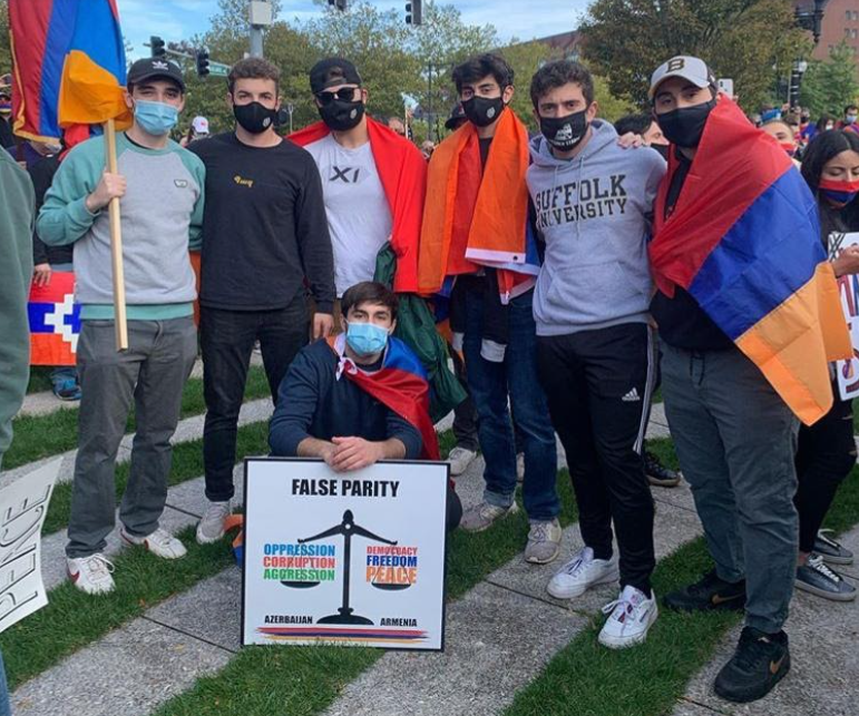 Suffolk student George Yeghyayan stands beside fellow Armenian-American students at the protest