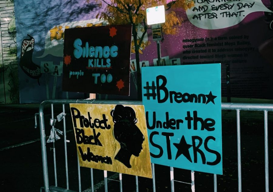 Signs honoring Breonna Taylor at Starlight Square in Cambridge.