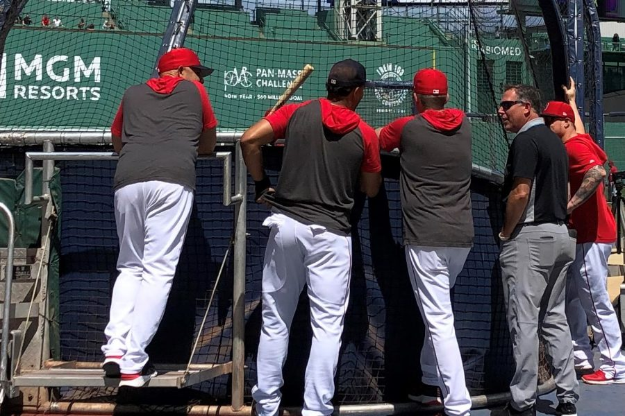 Alex Cora (far left) watches a pre-game batting practice on August 10,2019