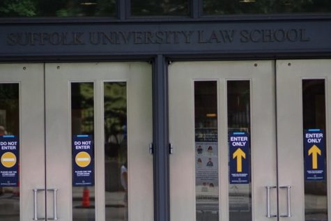 Social distancing instructions adorn the front doors of Suffolk University