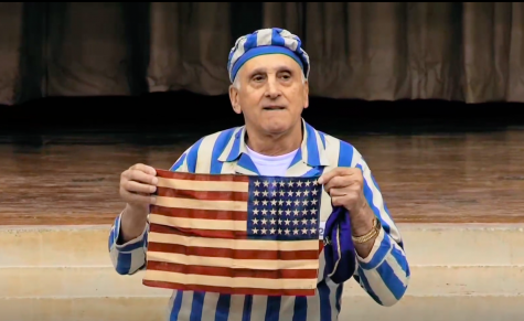 Steve Ross proudly displaying the flag that was given to him by an American soldier after he was liberated from Dachau.