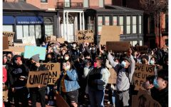 Demonstrators march during a March 14 Stop Asian Hate Rally in Boston.