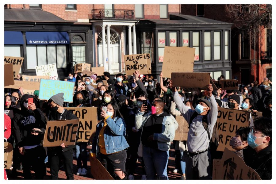 Demonstrators+march+during+a+March+14+Stop+Asian+Hate+Rally+in+Boston.