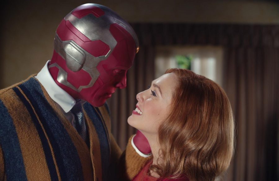 Paul Bettany and Elizabeth Olsen share a scene in Disneys WandaVision.