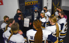 Womens hockey head coach Taylor Wasylk talks strategy to her team before their first game in almost a year