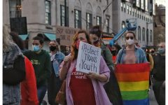 Demonstrators march on Beacon Street in solidarity with transgender youth across the country.