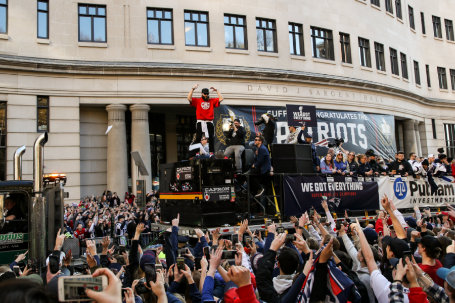 Julian Edelman celebrates the Patriots Super Bowl 53 victory in front of Sargent Hall in 2019