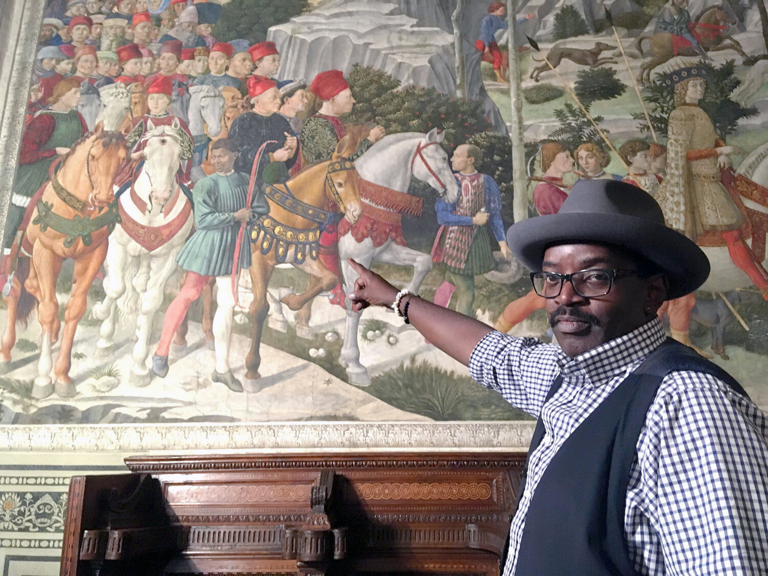 Visual artist, Fab 5 Freddy, shows off the Procession of the Magi fresco by Gozzoli.