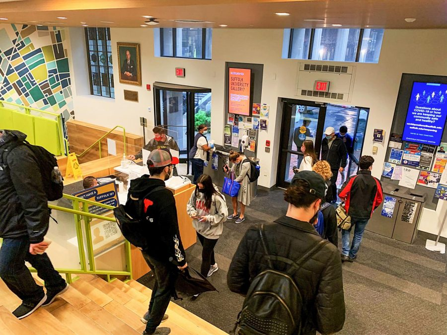 Students in the lobby of the Sawyer Building