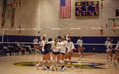 Suffolk volleyball celebrates their win over Lasell on Thursday