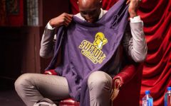Tacko Fall holds up his new Suffolk Rams sweatshirt in Modern Theatre on Sept 11